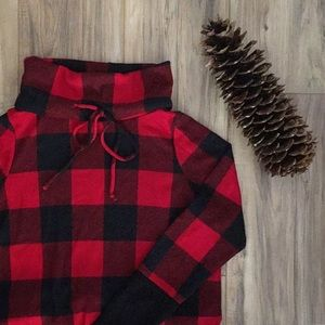 Plaid knit sweater top.